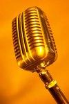 Antique silver microphone in orange light uid 1172391